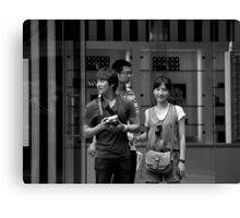 """Um..hun, there's a photographer taking photographs of us taking photographs"" Canvas Print"