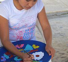 A young Artist working at the Street - Una joven Artista trabajando en la Calle by PtoVallartaMex