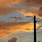 storm clouds at sunset by sharon wingard