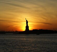 Lady Liberty with sunset by Mark  Johnstone