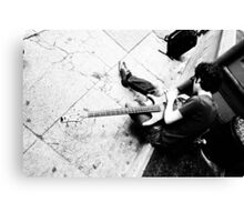 Cool guy fixing guitar Canvas Print