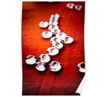 Glass beads on rust cloth Poster