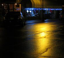 Rainy Night On Main St. by Jean Gregory  Evans