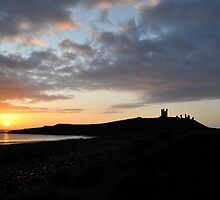 Dunstanburgh Castle at dawn by Pete  Burton