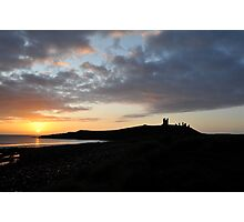 Dunstanburgh Castle at dawn Photographic Print