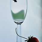 Wine in a glass and a strawberry. by larisa  fedotova