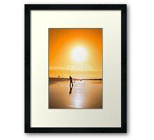 lone fisherman fishing on the sunset beach Framed Print