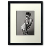 Beautiful blond girl standing in wet tee-shirt Framed Print
