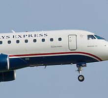 Tight Shot of US Airways Express N124HQ on Approach by Henry Plumley
