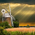 windmill with sunbeam sky by meirionmatthias