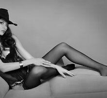 Beautiful brunette leggy girl wearing cowboy hat and seductive black lingerie by Anton Oparin