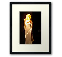 Angel Filled with Light on Earth Framed Print