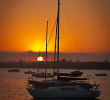 Sunrise on the water by Rick Hoult