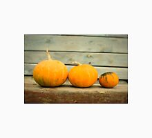 Pumpkins on a wooden background Unisex T-Shirt