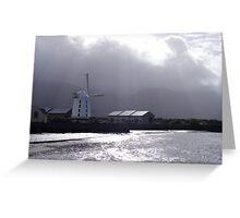 Light streams down through grey clouds - windmill sea Greeting Card