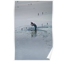 Balinese man pounding in a post off the coast of Nusa Penida, Bali, Indonesia Poster
