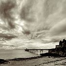 Clevedon Pier with storm clouds by Robert Down