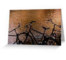 Silhouetted bicycles along a canal in Amsterdam, Holland Greeting Card