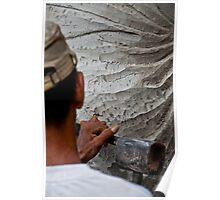 Stone carver at work in Batubulan, Bali, Indonesia. Poster