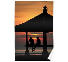 Two figures in a pagoda silhouetted against the rising sun in Bali, Indonesia Poster