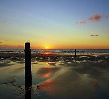 Sunset on a Dutch Beach by 7horses