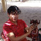 Young Man polishing a Carved Sculpture - Joven ligando una Esculptura Tallada by PtoVallartaMex