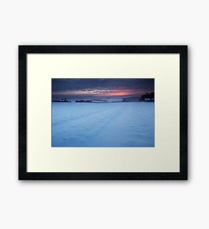 A Ruby Cut Across Winter's Cold White Veil Framed Print