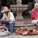 The Trader And The Tourist - El Comerciante Y El Turista by Bernhard Matejka