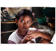 Balinese child in the Batik workshop, near Ubud, Bali. Poster