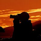 A Photographer Enjoying His Work by Kathy Baccari