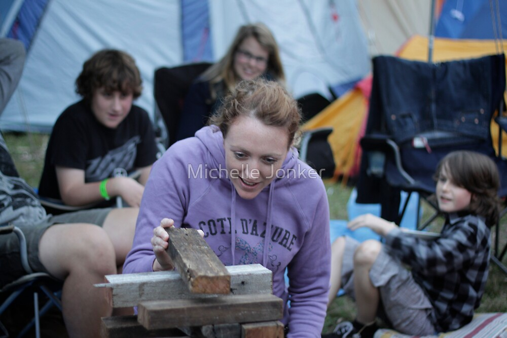 Quiet, Cal is concentrating on winning Campfire Jenga by Michelle Jonker