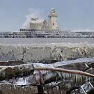 Wide shot of the Cleveland lighthouse in Winter by Henry Plumley