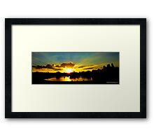 Sunset over tuks Framed Print