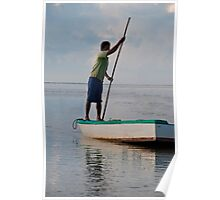 Fisherman poling his boat off Sanur Beach in Bali, Indonesia Poster
