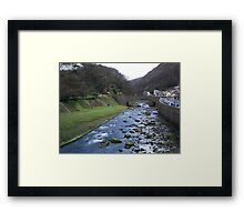 Village By The Rush Framed Print