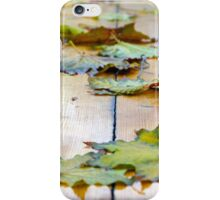 Selective focus on the autumn fallen maple leaves iPhone Case/Skin