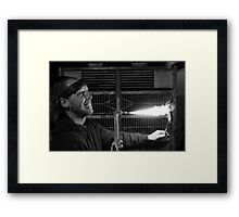 A hungry, mad man with a torch Framed Print