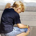 Boy Praying in Pearl Harbor  by MyraVeresPhoto