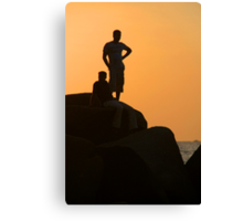 Silhouetted Figures on Rock at Sunset Palolem Canvas Print
