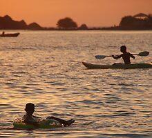 Kayak and Inflatable Ring at Sunset Palolem by SerenaB