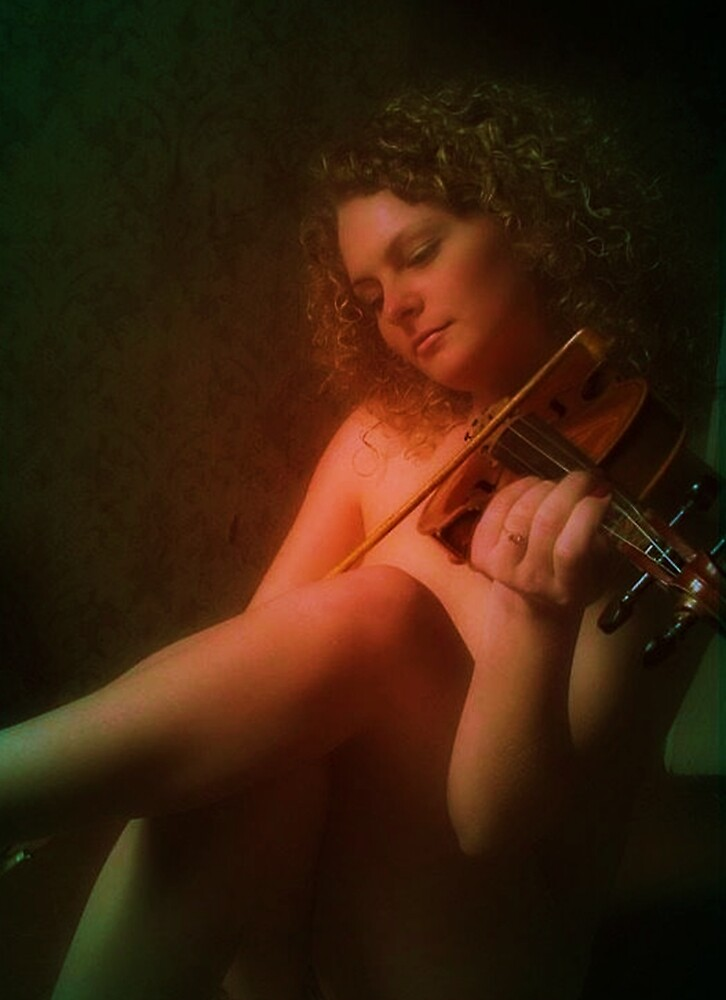 The Cry of a Lonely Heart Echoes From the Strings by Rick Wollschleger