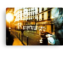 sun over parisian street Canvas Print