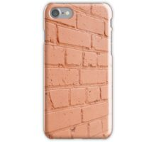 Angle view of a brick wall with a layer of red paint iPhone Case/Skin