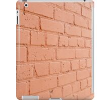 Angle view of a brick wall with a layer of red paint iPad Case/Skin