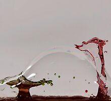 Water Drop Through Soap Bubble  by Richard Labelle