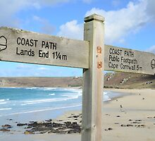 Which way to go? Signpost at Sennen Cove, Cornwall by jonshort58