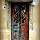 Rusty old door in Art Deco building by Julie Dawn Fox