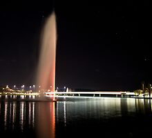 Captain Cook Water Jet in Lake Burley Griffin at night by Tony Theobald