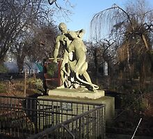 Wooden Sculpture/Lion vs Man/(1 of 3) -(190212)- digital photo by paulramnora