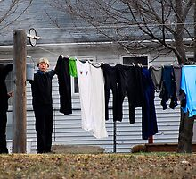 Amish Boy Hanging Clothes in Pennsylvania by KellyHeaton